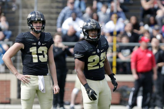 Purdue quarterback Jack Plummer (13) and Purdue running back Alfred Armour (22) look to the sidelines for the play during the first quarter of the Purdue University spring game, Saturday, April 6, 2019, at Ross-Ade Stadium in West Lafayette.(Nikos Frazier | The Journal & Courier)