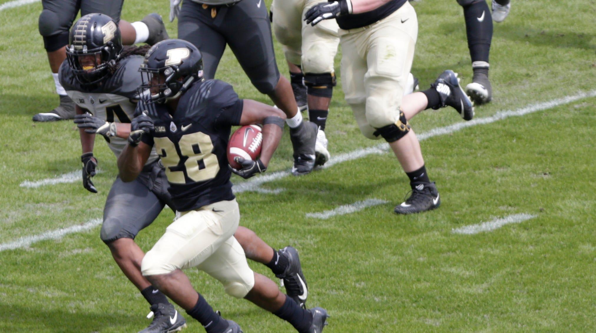 Purdue running back Evan Anderson (28) runs the...