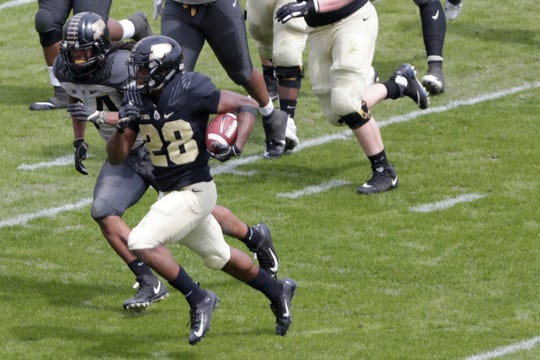 Purdue running back Evan Anderson (28) runs the ball during the third quarter of the Purdue University spring game, Saturday, April 6, 2019, at Ross-Ade Stadium in West Lafayette.(Nikos Frazier | The Journal & Courier)