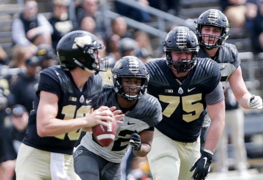 Purdue defensive back Elijah Ball (32) watches Purdue quarterback Aidan O'Connell (16) during the fourth quarter of the Purdue University spring game, Saturday, April 6, 2019, at Ross-Ade Stadium in West Lafayette.