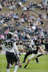 Purdue kicker J.D. Dellinger (85) kicks in an extra point during the second quarter of the Purdue University spring game, Saturday, April 6, 2019, at Ross-Ade Stadium in West Lafayette.