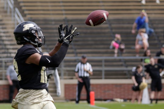 Purdue wide receiver Jared Sparks (12) catches a pass to score a touchdown during the second quarter of the Purdue University spring game, Saturday, April 6, 2019, at Ross-Ade Stadium in West Lafayette.