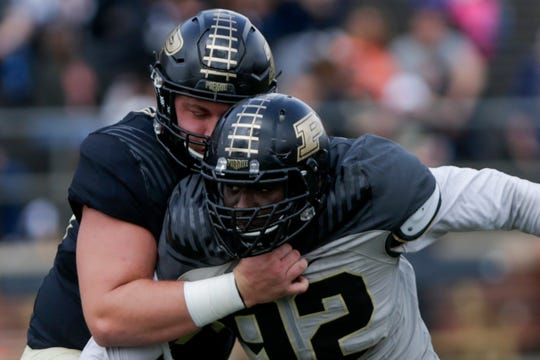 Purdue offensive lineman Viktor Beach (56) blocks Purdue defensive end Giovanni Reviere (92) during the first quarter of the Purdue University spring game, Saturday, April 6, 2019, at Ross-Ade Stadium in West Lafayette.(Nikos Frazier | The Journal & Courier)