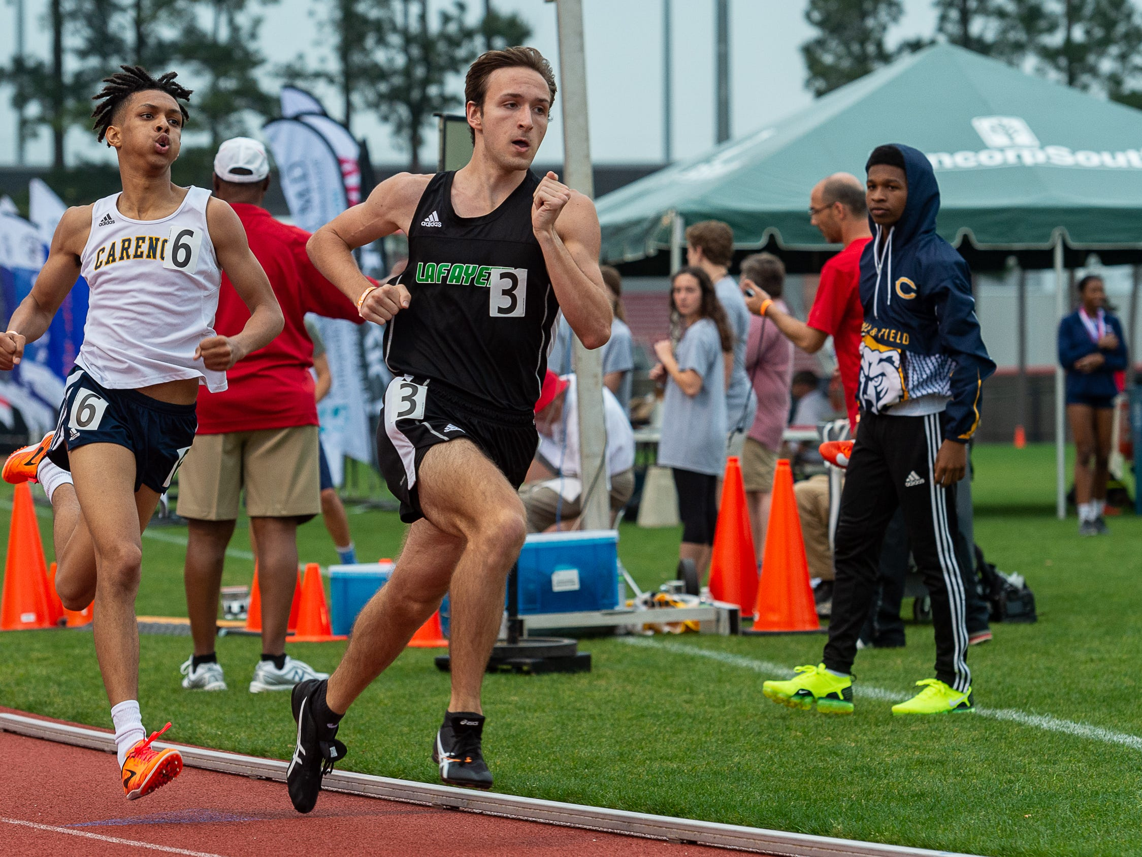 Riley Plunkett leads and goes on to win the 800m run at The 2019 Beaver Club Relays. Friday, April 5, 2019.