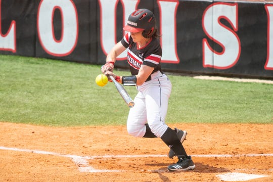 UL's Keeli Milligan makes contact with the ball as the Ragin' Cajuns take on the University of Texas Arlington Mavericks in a double-header at Yvette Girouard Field on Saturday, April 6, 2019.