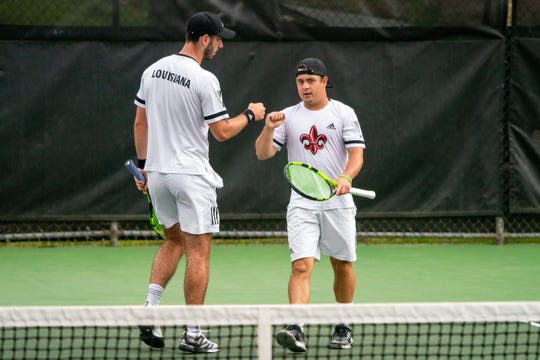 UL's Pearse Dolan (left) commends Arthur Libaud (right) in between games as the Ragin' Cajuns take on the South Alabama Jaguars at Cajun Courts on Friday, April 5, 2019.
