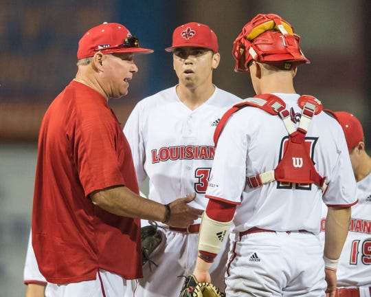UL coach Tony Robichaux talks to pitcher Grant Cox and catcher Kole McKinnon during Friday night's loss to Arkansas State.