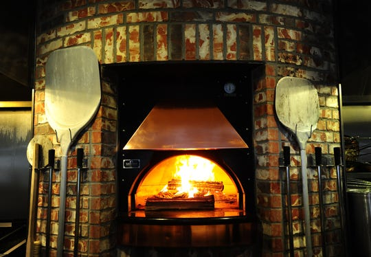 The wood-burning oven is a centerpiece of the kitchen at Social Southern Table & Bar in Lafayette, LA