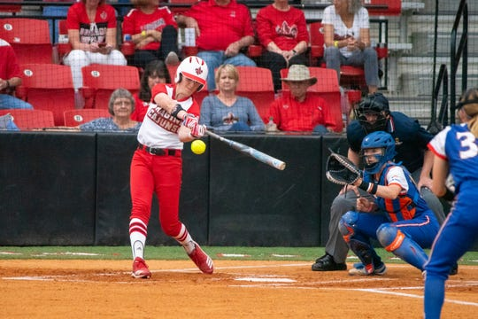 UL's Sarah Hudek hits the incoming pitch as the Ragin' Cajuns take on the University of Texas Arlington Mavericks at Yvette Girouard Field on Friday, April 5, 2019.
