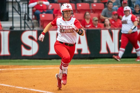 UL's Lexie Comeaux sprints to first base as the Ragin' Cajuns take on the University of Texas Arlington Mavericks at Yvette Girouard Field on Friday, April 5, 2019.