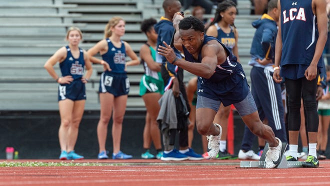 Terrence Jones of LCA runs in the 4x100m relay at the Beaver Club Relays on April 5.