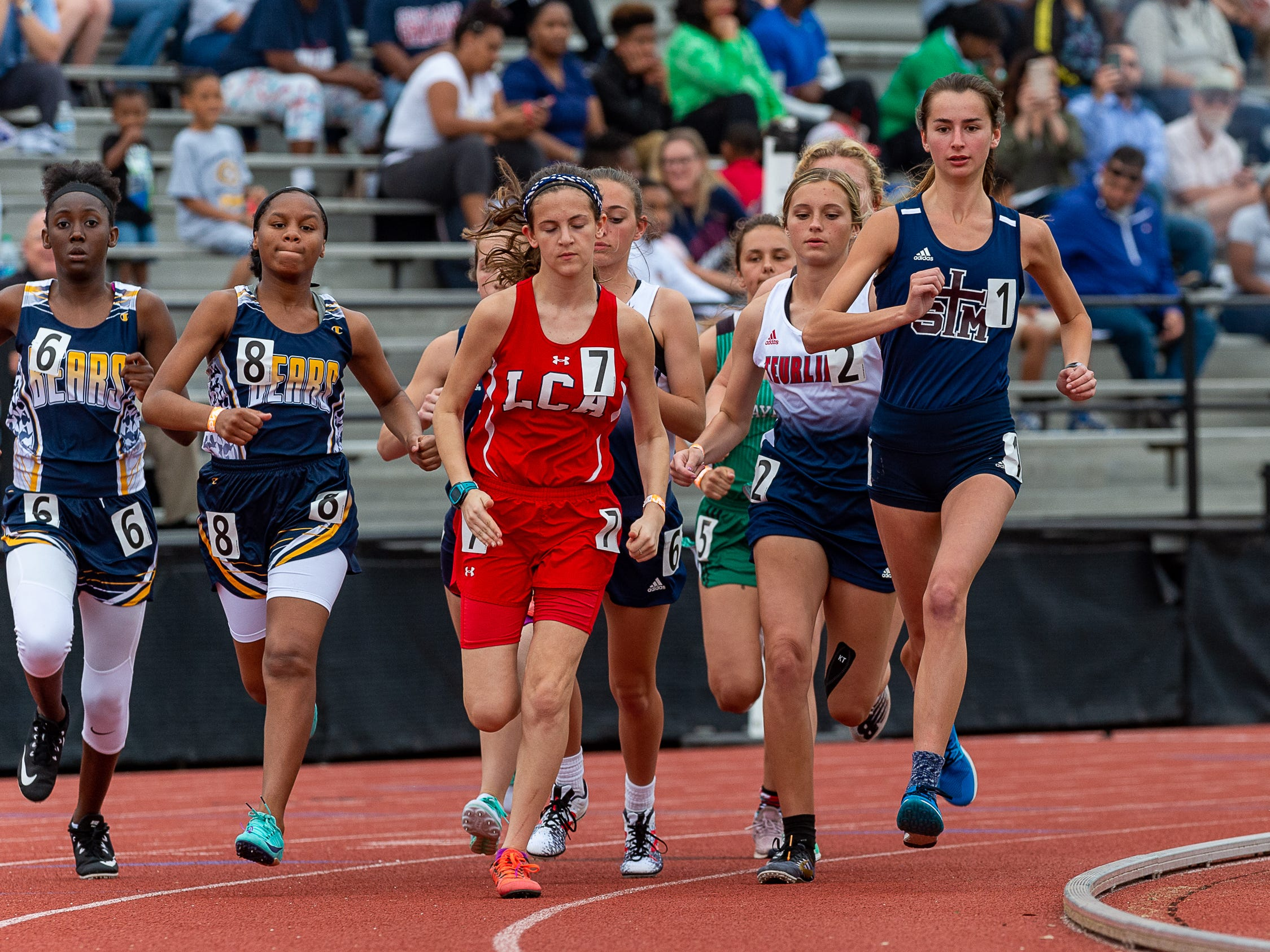 Mia Parker leads from start to finish and wins the 1600m run at The 2019 Beaver Club Relays. Friday, April 5, 2019.