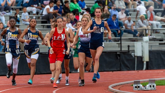 St. Thomas More's Mia Parker, shown here at the Beaver Club Relays on April 5, won first place in the 1600 and 3200 in the District 4-4A meet, helping the Lady Cougars to win title.