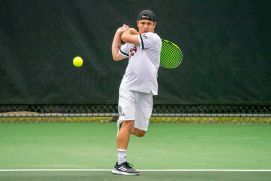 UL's Arthur Libaud hits the ball over the net as the Ragin' Cajuns take on the South Alabama Jaguars at Cajun Courts on Friday, April 5, 2019.