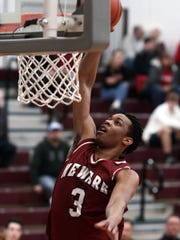 Newark's Keshawn Heard goes up for a dunk during Friday's District 11 All-Star game at Newark.