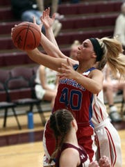 Licking Valley's Emily Hartshorn grabs a rebound during Friday's District 11 All-Star game at Newark.