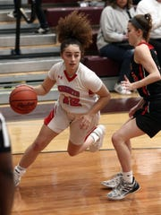Fairfield Christian's Celeste Mershimer drives to the basket during Friday's District 11 All-Star game at Newark.