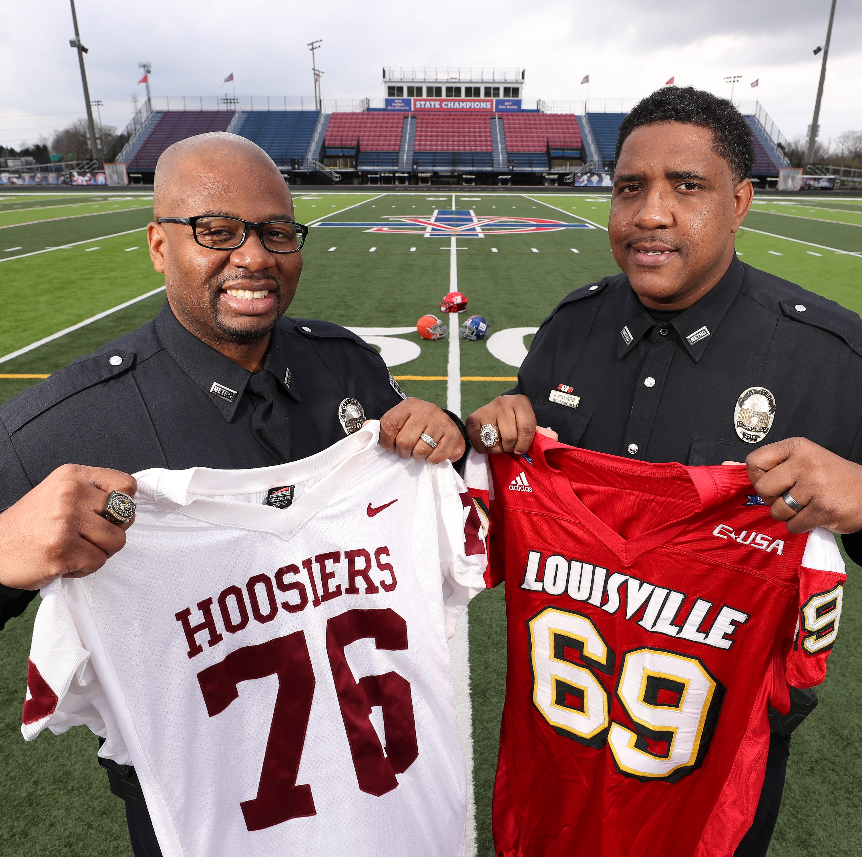 Former NFL football players Isaac Sowells, left,...