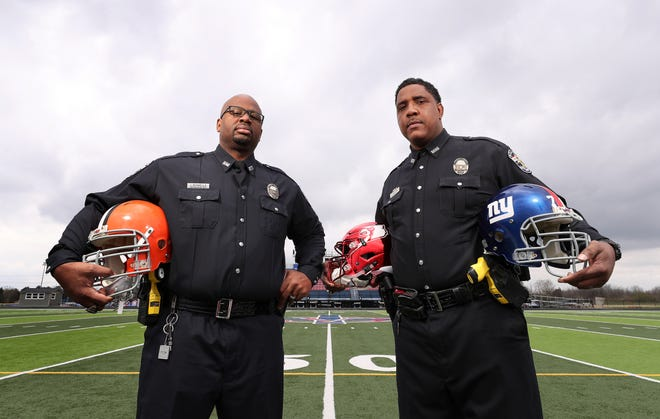 Former NFL football players Isaac Sowells, left, and Jason Hilliard are now Louisville Metro Police officers.  Sowells played at Central High School, Indiana University and the Cleveland Browns.  Hilliard played at Jeffersonville High School, the University of Louisville and the New York Giants.  Sowells won a high school championship ring with Central and Hilliard won a high school championship ring as an assistant coach at Christian Academy of Louisville.