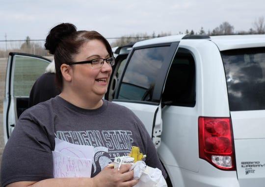 Bobbiejo Bruff is happy to see volunteers work to repair her tornado damaged home Saturday, April 6, 2019.
