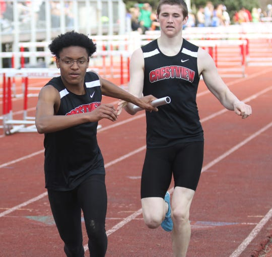 James Barber, taking the baton from Ross Kuhn, has battled epilepsy and asthma to become a state-qualifying cross country runner and relay anchor for the Crestview Cougars.