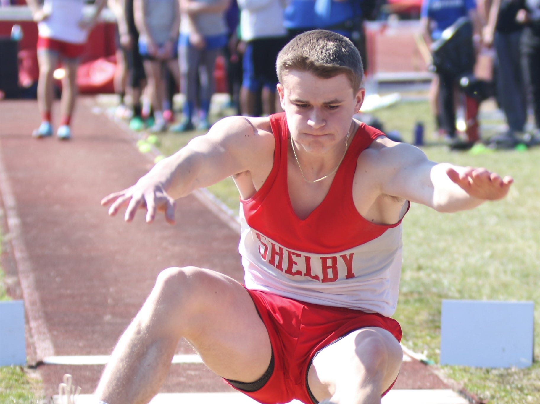 Shelby's Caleb Henkel popped off three 20-plus-foot jumps in the long jump competition during the Shelby High School Invite on Saturday afternoon.