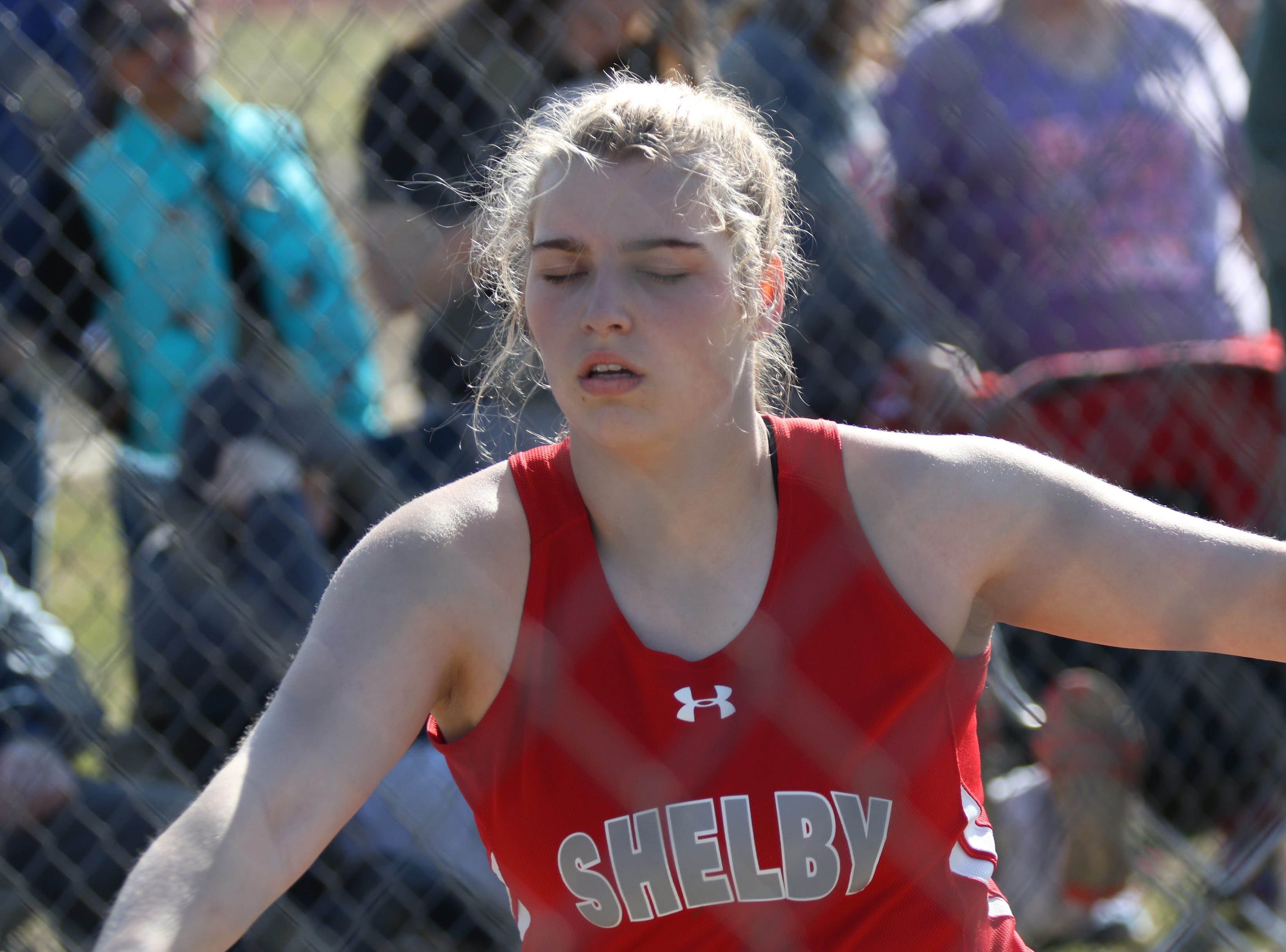 Shelby's Bailey Walter visualizes her attempt during the girls shot put competition during the Shelby High School Invitational on Saturday afternoon.