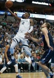 Memphis Grizzlies guard Delon Wright (2) drives past Dallas Mavericks forward Dirk Nowitzki (41) during the first half of an NBA basketball game in Dallas, Friday, April 5, 2019. (AP Photo/LM Otero)