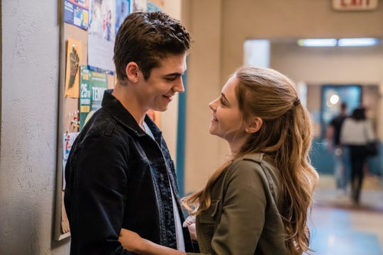 "Hardin Scott (Hero Fiennes Tiffin) is drawn in by Tessa Young's (Josephine Langford) smile in ""After."""