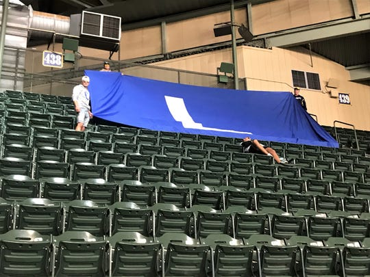 A giant custom 'L' flag, which made an appearance at a Cubs-Brewers game in September of 2018, was on display again in the ninth inning of Milwaukee's 13-10 win on Friday night.