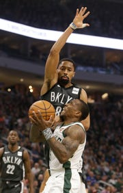 Milwaukee Bucks' Eric Bledsoe drives against Brooklyn Nets' Spencer Dinwiddie during the first half of an NBA basketball game Saturday, April 6, 2019, in Milwaukee. (AP Photo/Jeffrey Phelps) ORG XMIT: WIJP102