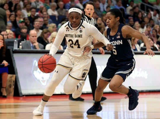 Arike Ogunbowale looks to drive against the defense of UConn's Crystal Dangerfield during the semifinals of the 2019 NCAA Women's Final Four on Friday night.