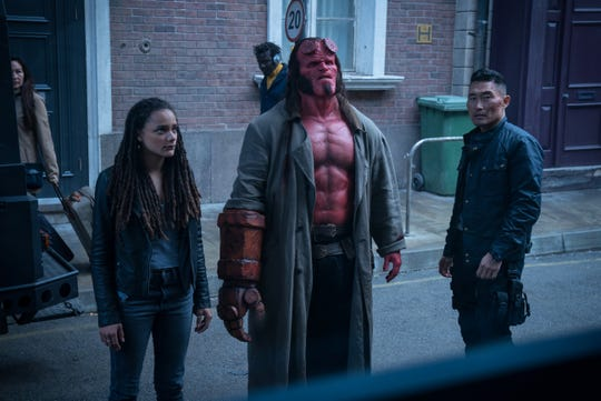 "Hellboy (David Harbour, center, with Sasha Lane and Daniel Dae Kim) assesses the not-great situation in ""Hellboy."""