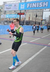 Martin Erl of Milwaukee celebrates his victory in the Milwaukee Marathon on Saturday, April 6, 2019.