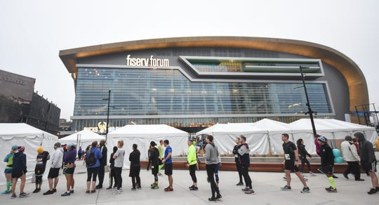 Runners and spectators await the start of the Milwaukee Marathon near Fiserv Forum in downtown Milwaukee on Saturday, April 6, 2019.