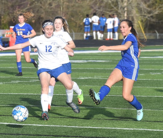 Mountain Home's Madilyn Jones (right) scores a goal during the Lady Bombers' 10-0 victory over West Memphis on Friday night.