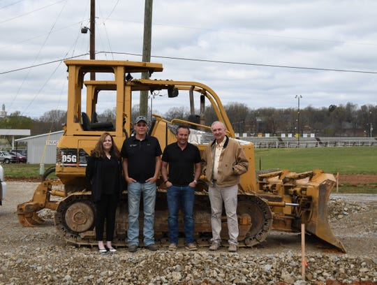 American Epoxy Scientific President and CEO Steve Luelf (far right) is joined by (from left) Sales and Marketing Director Dawn Jacobs, Operations Manager Michael Miles and general contractor Will Gregory at the site of the business' 30,000 square-foot expansion that is expected to be completed this fall.