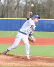 Mountain Home pitcher Satch Harris delivers to the plate against Fayetteville on Friday.