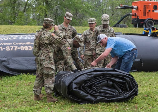 Members of the Louisiana National Guard assist in folding an inflatable water barrier after conducting flood rescue training operations at the Sterlington Operations Center along the banks of the Ouachita River in Sterlington, La. on April 6. The event was held in cooperation with the Governor's office.
