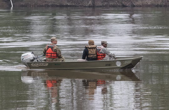 Members of the Louisiana National Guard ride a small boat back to shore after conducting flood rescue training operations at the Sterlington Operations Center along the banks of the Ouachita River in Sterlington, La. on April 6. The event was held in cooperation with the Governor's office.