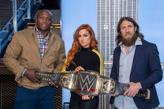 WWE Superstars Bobby Lashley, from left, Becky Lynch and Daniel Bryan visit the Empire State Building to promote WrestleMania 35 on Friday, April 5, 2019, in New York. (Photo by Charles Sykes/Invision/AP)