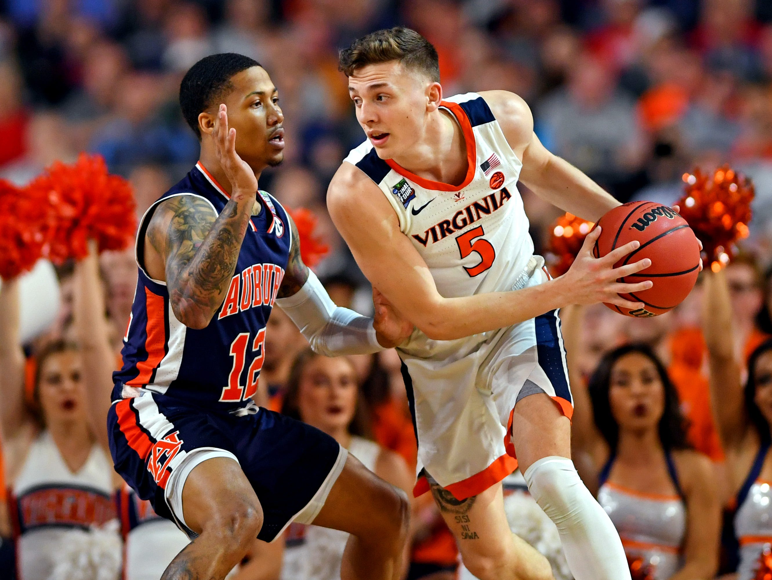 Apr 6, 2019; Minneapolis, MN, USA; Virginia Cavaliers guard Kyle Guy (5) handles the ball against Auburn Tigers guard J'Von McCormick (12) during the second half in the semifinals of the 2019 men's Final Four at US Bank Stadium. Mandatory Credit: Bob Donnan-USA TODAY Sports