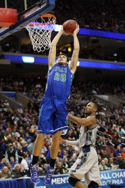 Florida Gulf Coast's Chase Fieler dunks against Georgetown during the NCAA tournament at the Wells Fargo Center in Philadelphia in March 2013.