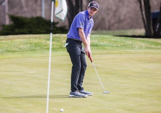 Central's Nick Phillips putts at the Yorktown Invitational at the Player's Club in Yorktown Saturday morning.