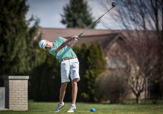 FILE -- Yorktown's Carson Orr swings during the Yorktown Invitational at the Player's Club in Yorktown Saturday morning.