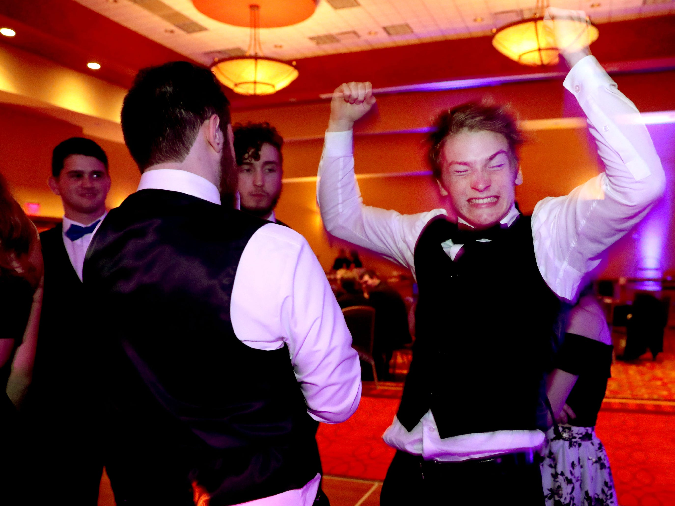 Christian d'Oliveira starts dancing on the dance floor at Eagleville's Prom held at Embassy Suites, in Murfreesboro on Thursday April 5, 2019.