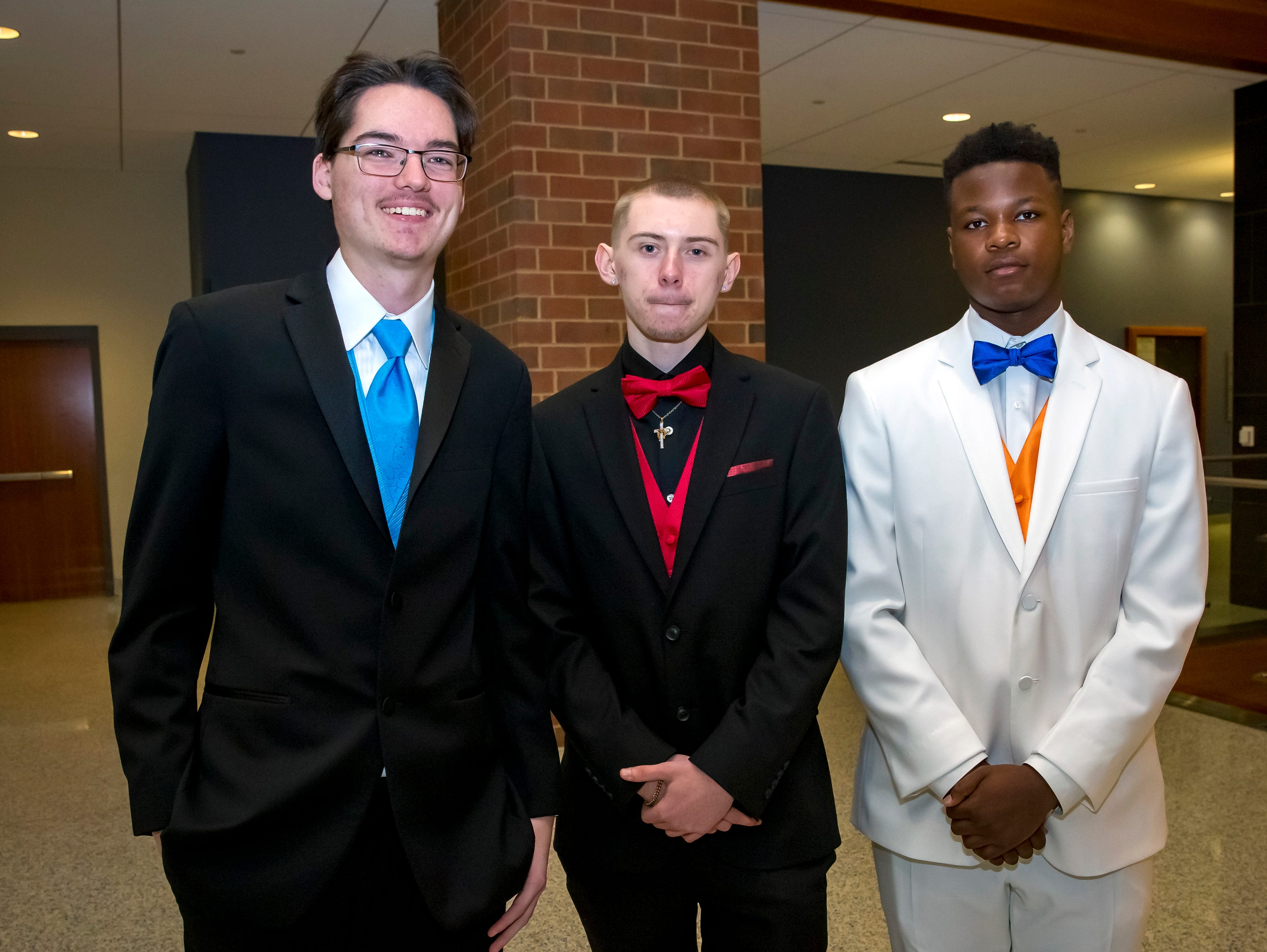 Colby Lemay, Skylar Garriott and Victor Fitzgerald arrive at the Stewarts Creek High School prom held at MTSU, Friday, April 5, 2019.