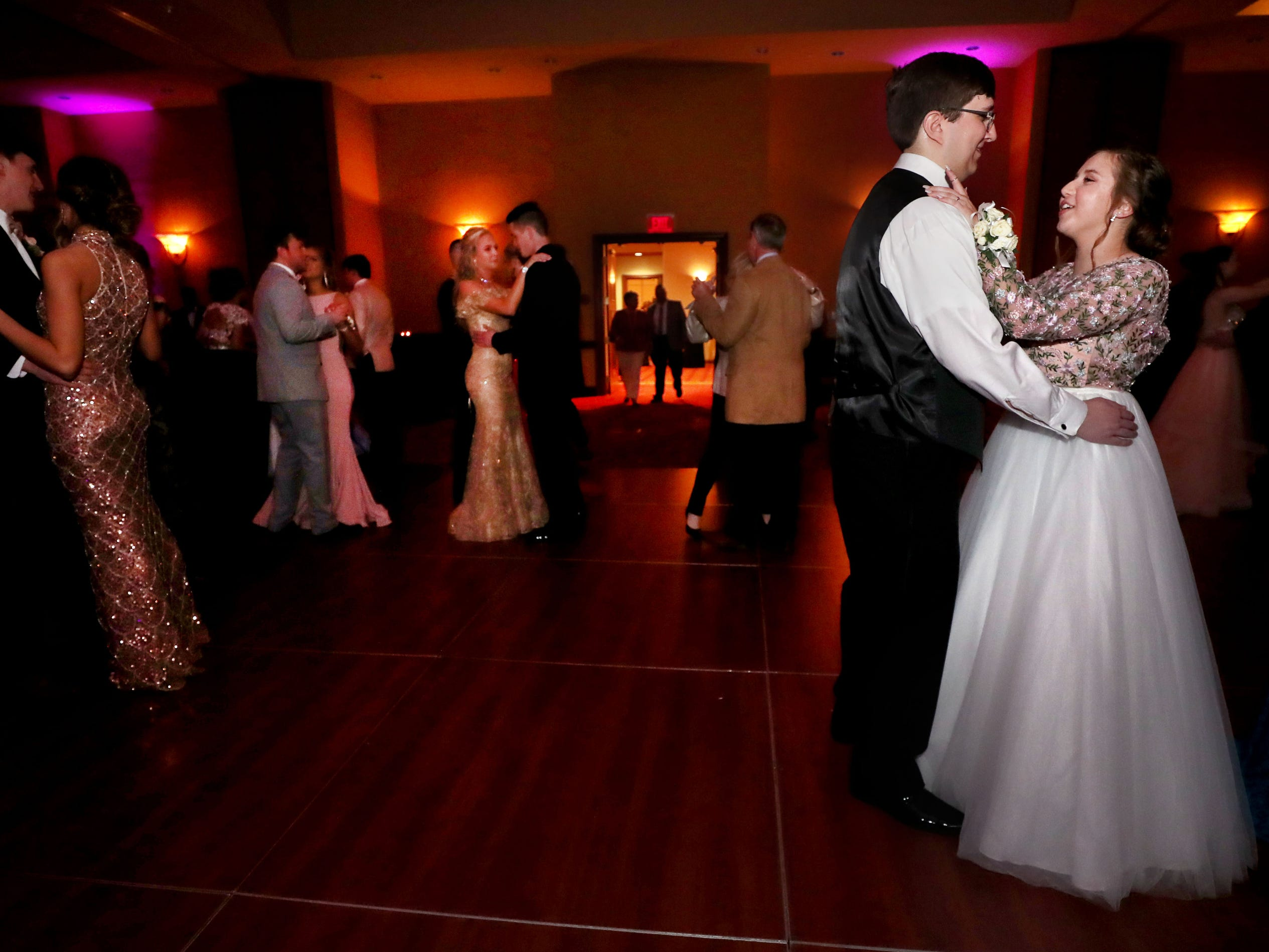 """Nicholas Johnson, left  and Daisy Hall, right dance to """"At Last"""" at Eagleville's Prom held at Embassy Suites, in Murfreesboro on Thursday April 5, 2019."""