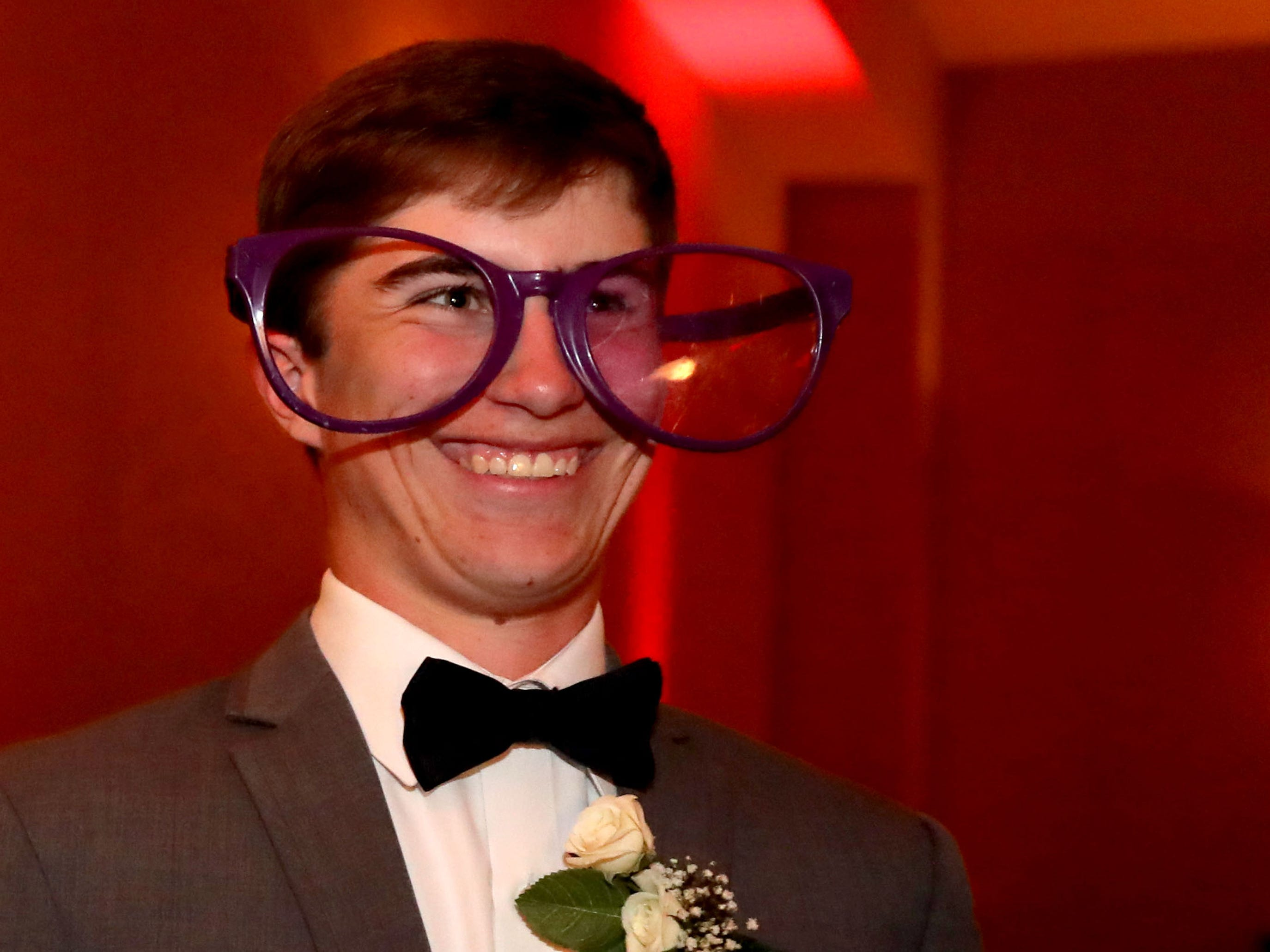Will Graves tries on big glasses for a picture at Eagleville's Prom held at Embassy Suites, in Murfreesboro on Thursday April 5, 2019.