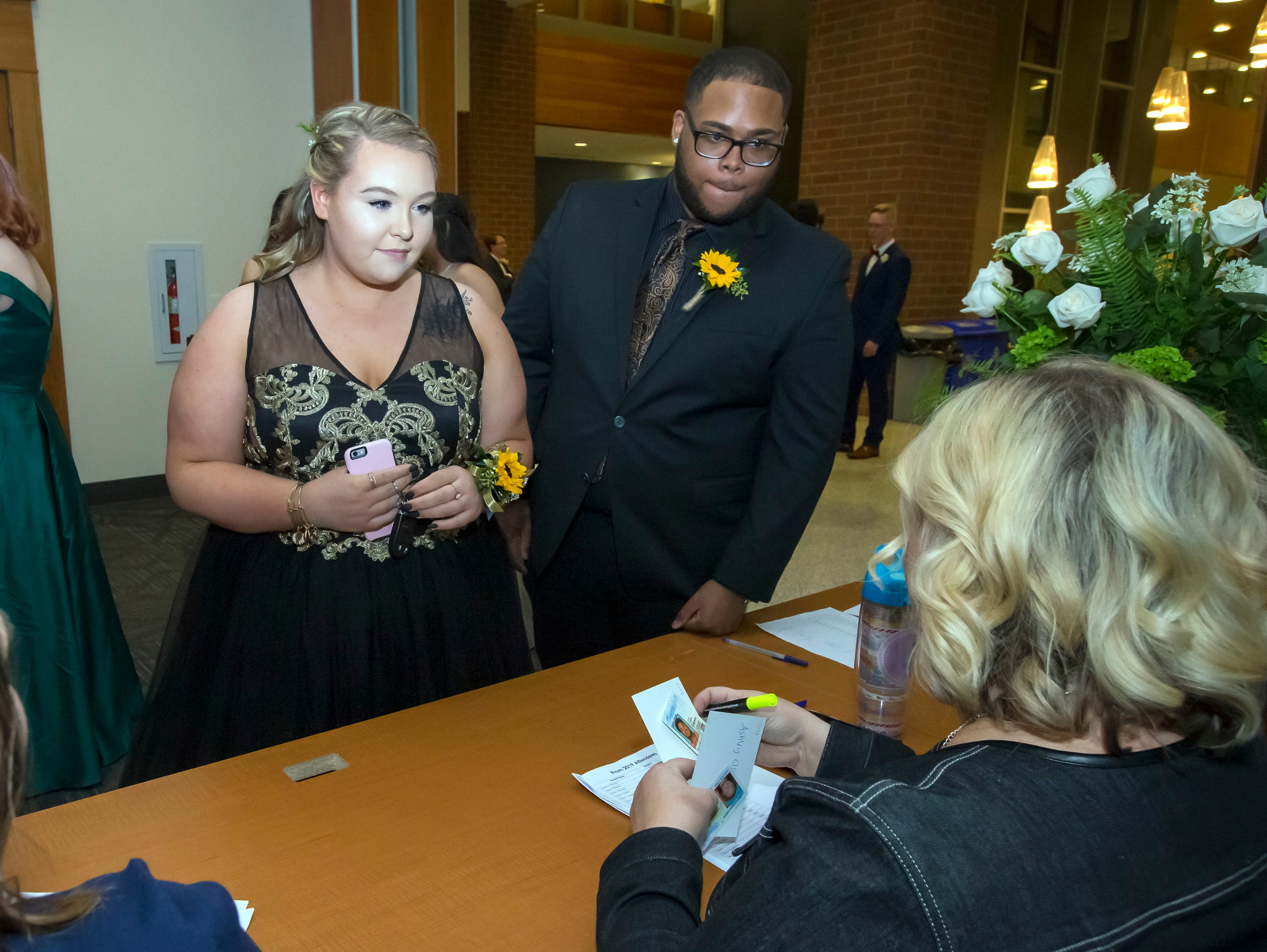 Checking in after arriving at the Stewarts Creek High School prom held at MTSU, Friday, April 5, 2019.JIM DAVIS/for the DNJ